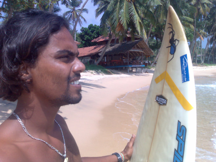 1-suranga-with-surfboard.jpg